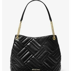 Large quilted tote handbag